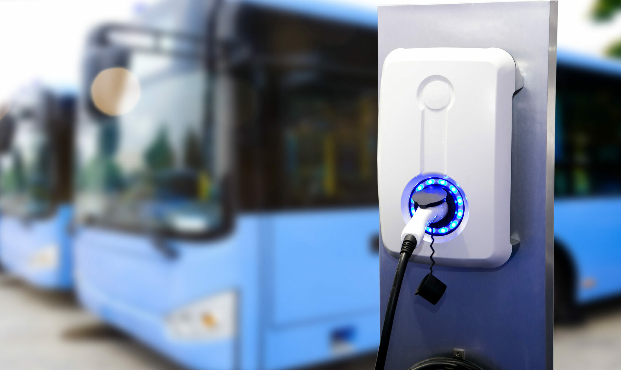 Commercial coaches being charged by charge point